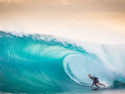 A surfer is in the barrel of a near perfect wave in the Mentawai islands of Indonesia. Photographed in August 28/2014